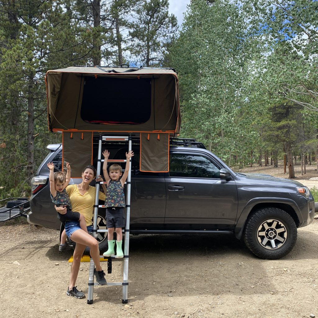mom and two sons standing next to a 4runner with a rooftop tenting for the top places to camp in colorado blog post